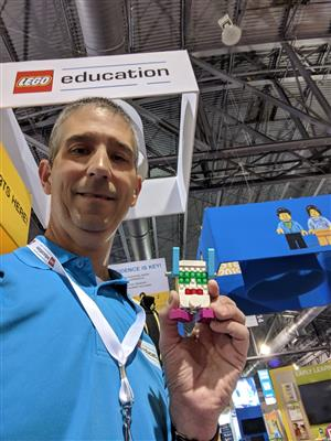 Dan Thomas holds LEGOs at a recent conference in Philadelphia.